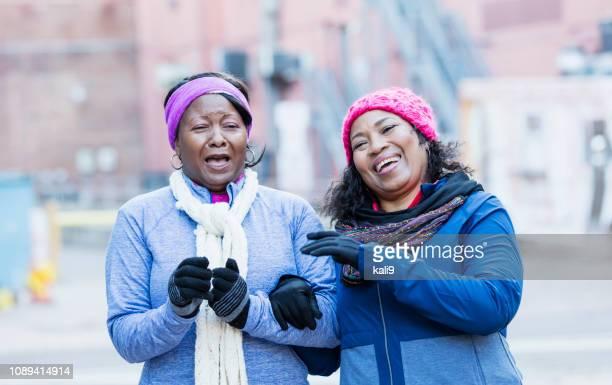 African-American women, friends having fun in city