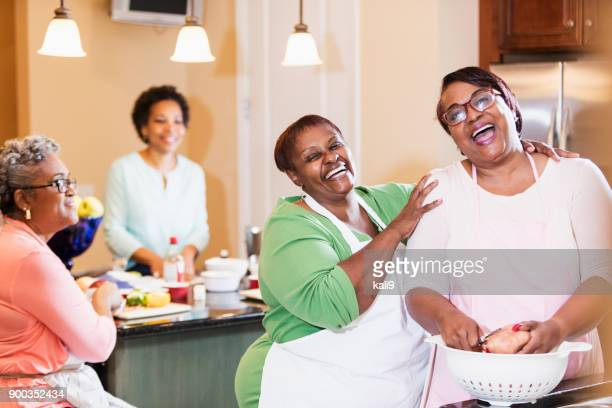 african-american women in kitchen cooking - fat nutrient stock pictures, royalty-free photos & images