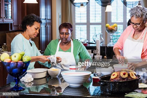 African-American women in kitchen cooking