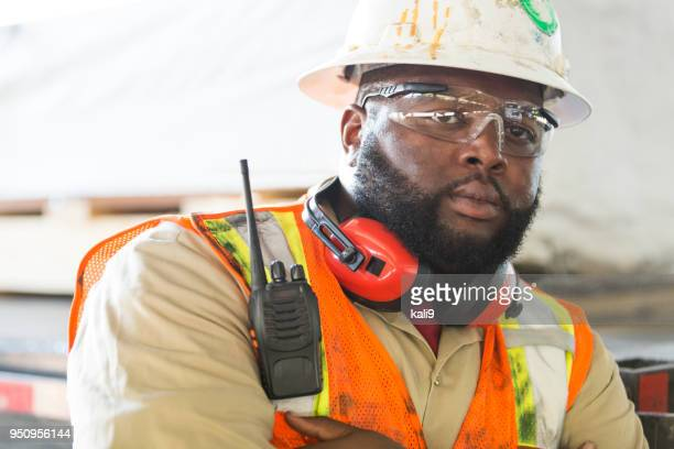 african-american worker in hardhat, reflective vest - protective eyewear stock pictures, royalty-free photos & images