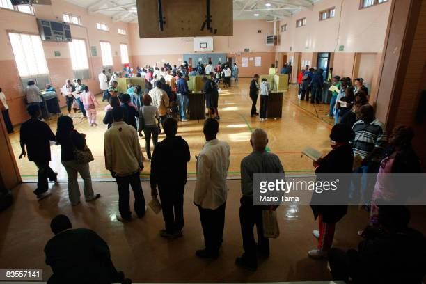 AfricanAmericans line up to vote in a recreation center in the presidential election November 4 2008 in Birmingham Alabama Birmingham along with...