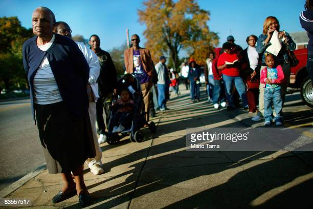 AfricanAmericans line up to vote in the presidential election November 4 2008 in Birmingham Alabama Birmingham along with Selma and Montgomery were...