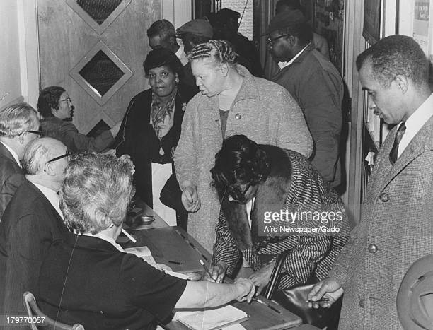 AfricanAmericans registering to vote as part of National Association for the Advancement of Colored People voter registration drive April 7 1964