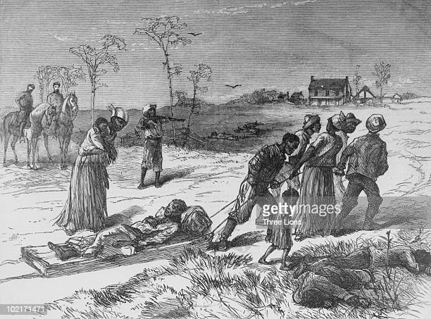 AfricanAmericans take away the dead and wounded after an attack by white supremacists in Louisiana 1873
