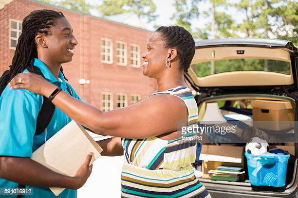 African-descent boy moves into college and tells mom goodbye.