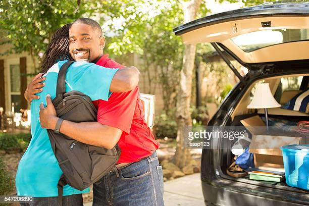 African-descent boy moves off to college.  Packed car, dad.  Home.