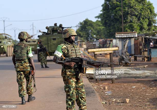 Africanled International Support Mission to the Central African Republic soldiers stand guard as Chadian soldiers are escorted out of Bangui on April...