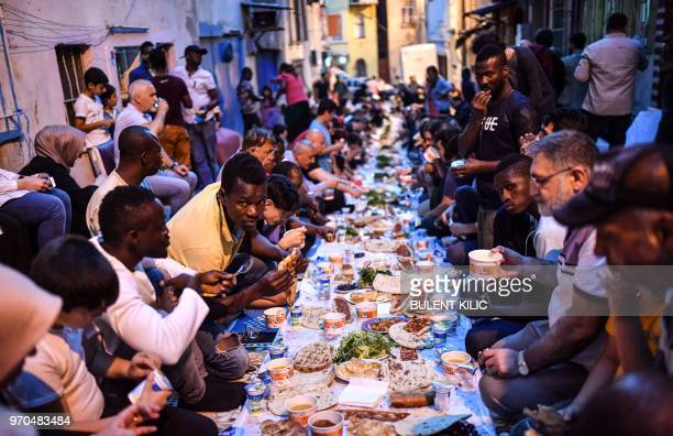 Africans and Turkish people break their fasting in Tarlabasi district of Istanbul on June 9 2018 Tarlabasi Solidarity Aasosiation organises iftar the...