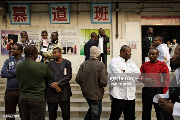 Africans, Chinese and other foreigners leave Sunday Mass December 14, 2008 in the cathedral in Guangzhou, China. The African community has settled...