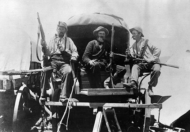 Afrikaners armed with rifles on a wagon during the...