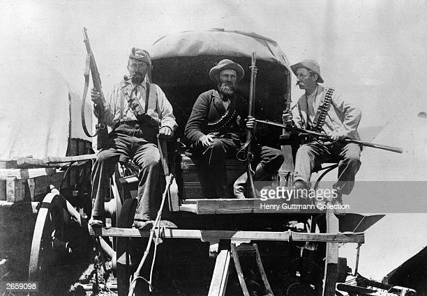 Afrikaners armed with rifles on a wagon during the second Boer War