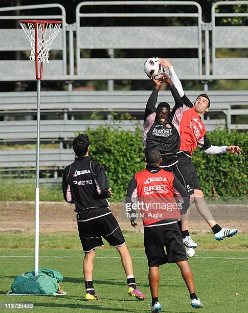 Afriyie Acqua and Cesare Bovo in action during a Palermo training session at Tenente Carmelo Onorato Sports Center on May 5, 2011 in Palermo, Italy.