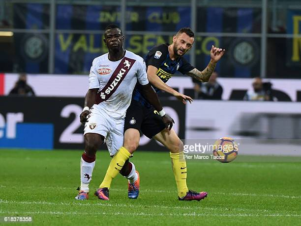 Afriyie Acquah of FC Torino competes for the ball with Marcelo Brozovic of FC Internazionale during the Serie A match between FC Internazionale and...