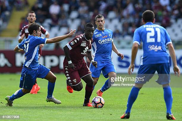 Afriyie Acquah of FC Torino in action against Daniele Croce of Empoli FC during the Serie A match between FC Torino and Empoli FC at Stadio Olimpico...