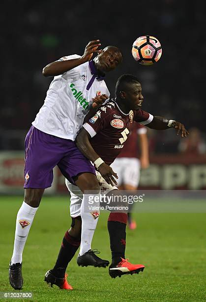 Afriyie Acquah of FC Torino is challenged by Khouma Babacar of ACF Fiorentina during the Serie A match between FC Torino and ACF Fiorentina at Stadio...