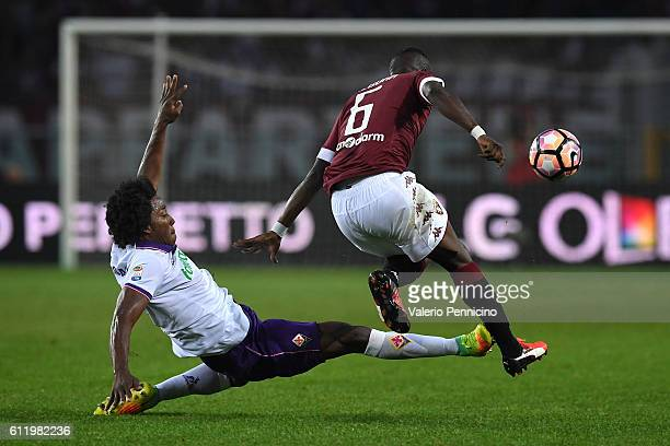 Afriyie Acquah of FC Torino is tackled by Carlos Sanchez of ACF Fiorentina during the Serie A match between FC Torino and ACF Fiorentina at Stadio...
