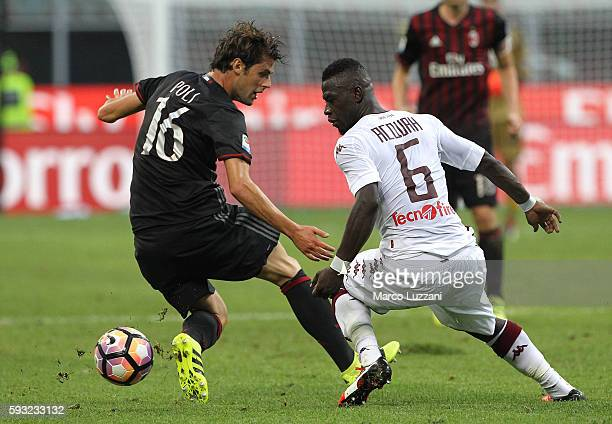 Afriyie Acquah of Torino FC competes for the ball with Andrea Poli of AC Milan during the Serie A match between AC Milan and FC Torino at Stadio...