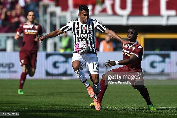 Afriyie Acquah of Torino FC competes with Alex Sandro of Juventus FC during the Serie A match between Torino FC and Juventus FC at Stadio Olimpico di...