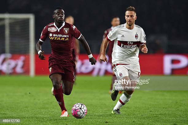 Afriyie Acquah of Torino FC in action against Andrea Bertolacci of AC Milan during the Serie A match between Torino FC and AC Milan at Stadio...