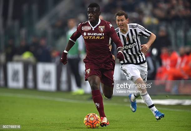 Afriyie Acquah of Torino FC in action against Stephan Lichtsteiner of FC Juventus during the TIM Cup match between FC Juventus and Torino FC at...
