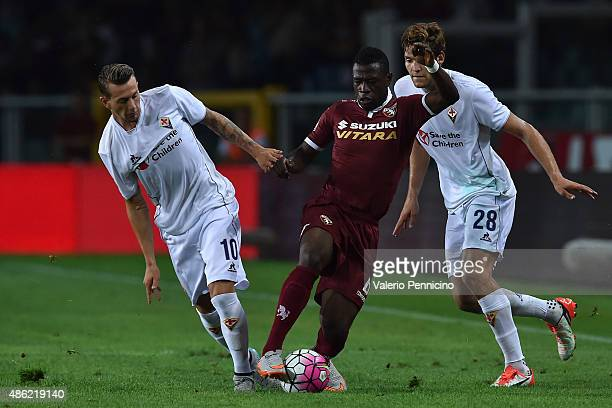 Afriyie Acquah of Torino FC is challenged by Federico Bernardeschi of ACF Fiorentina during the Serie A match between Torino FC and ACF Fiorentina at...