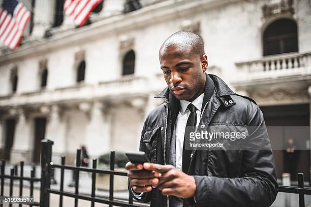 Afro american business man on the phone in wall street