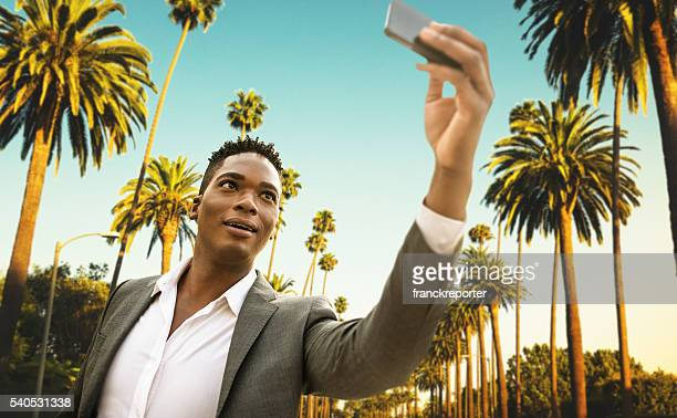 Afro american Business man take a selfie in beverly hills