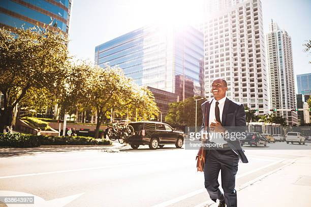 afro american businessman running in miami downtown
