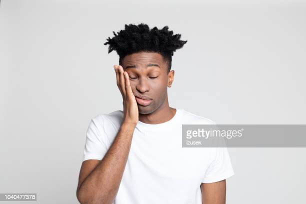 afro american man with pain in gums - exhaustion stock pictures, royalty-free photos & images