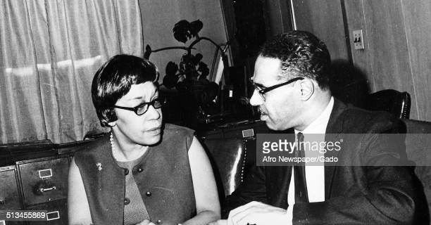Afro American Newspapers reporter Elizabeth Bettye Murphy Phillips with a newspaper having a conversation 1967