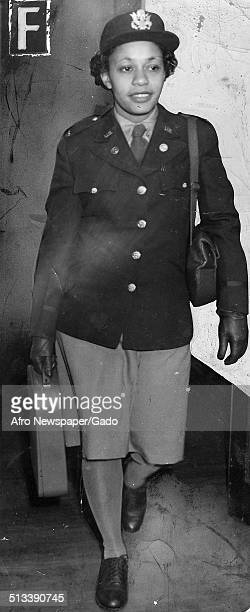 Afro American Newspapers reporter Elizabeth Bettye Murphy Phillips wearing military uniform walking 1960