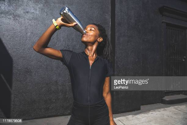 afro american woman with dreadlocks in a great athletic shape working out and training hard outdoors - reusable stock pictures, royalty-free photos & images