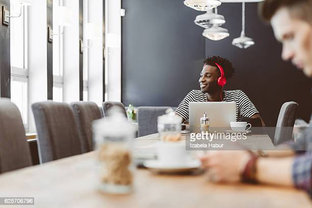 Afro american young guy in a coffee shop