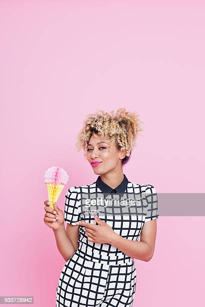 Afro American young woman holding ice cream honeycomb decorations