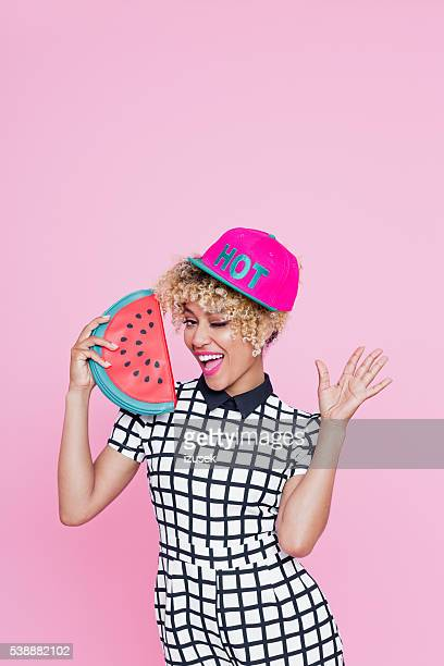 Afro American young woman holding watermelon bag