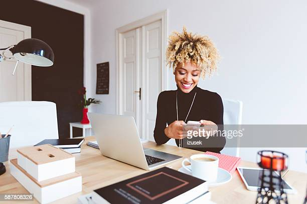 Afro american young woman in a home office