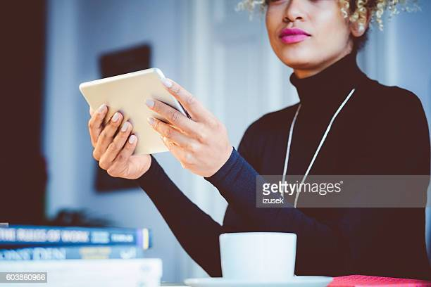 Afro american young woman using digital tablet in an office