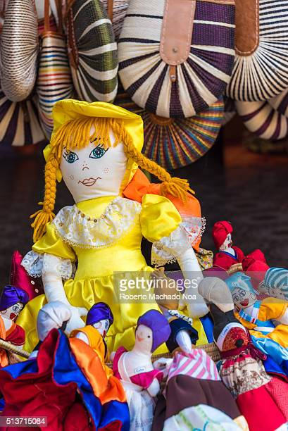 Afro Caribbean santeria religious dolls for sale as tourist souvenirs Selling colorful homemade dolls to make extra income