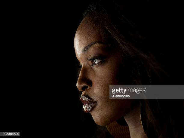 afro caribbean woman profile on black background