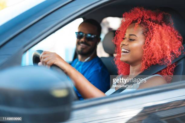 afro couple traveling by car - buying a car stock pictures, royalty-free photos & images