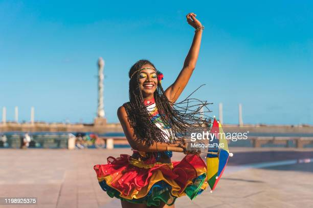 afro dancer holding a frevo umbrella in marco zero - carnival stock pictures, royalty-free photos & images