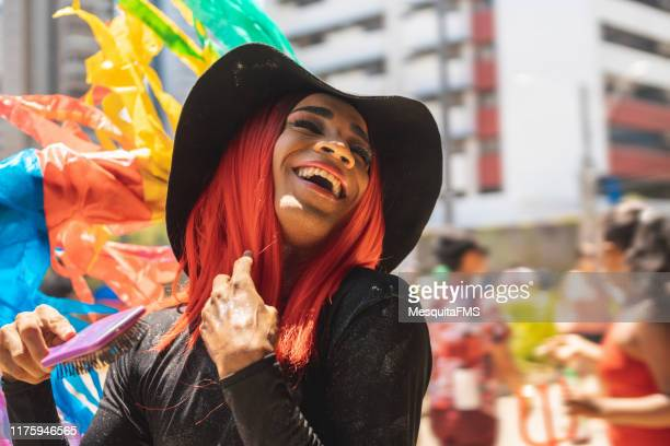 afro drag queen laughing out loud at the outdoor lgbt parade - drag queen stock pictures, royalty-free photos & images