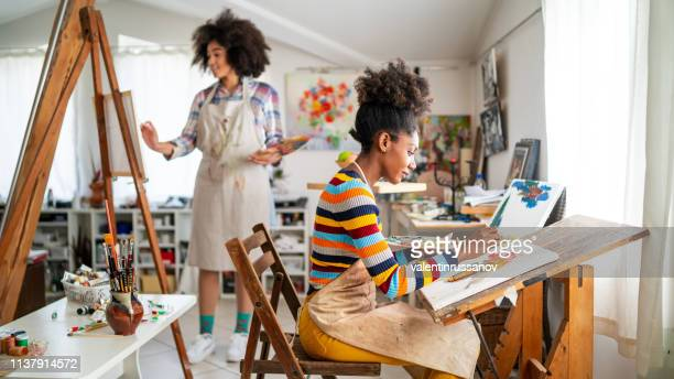 afro female fine artists drawing in studio - art stock pictures, royalty-free photos & images