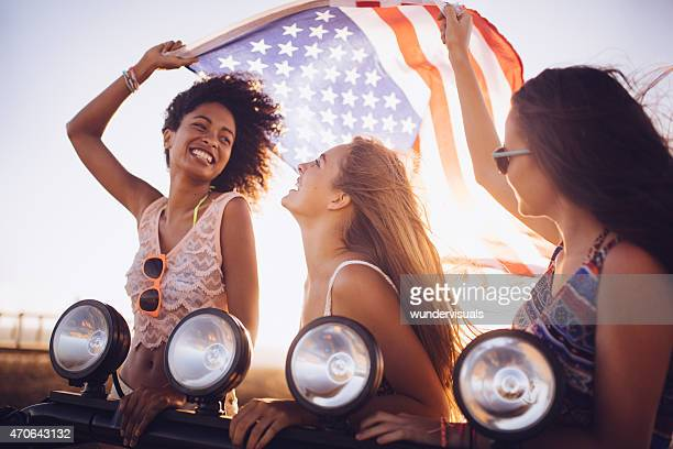 Afro girl flying an American flag with friends