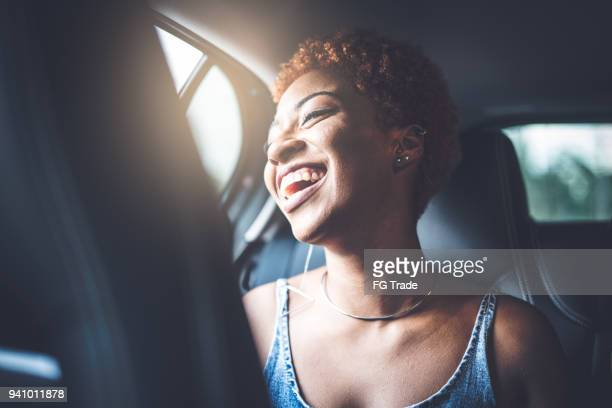 afro girl inside a car - car pooling stock photos and pictures