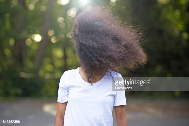 Afro hair girl in the park