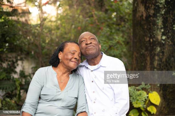 afro hispanic active senior together - contemplation couple stock pictures, royalty-free photos & images