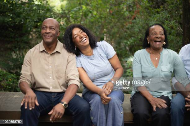 afro hispanic family together in the park - contemplation family stock pictures, royalty-free photos & images