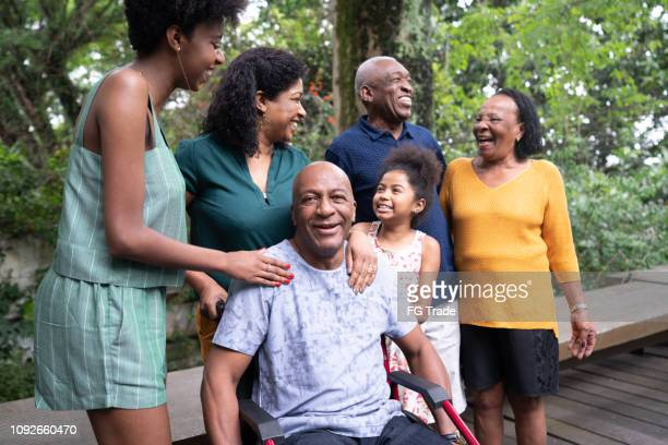 Afro hispanic-latino multi-generation family, and one of them on wheelchair portrait