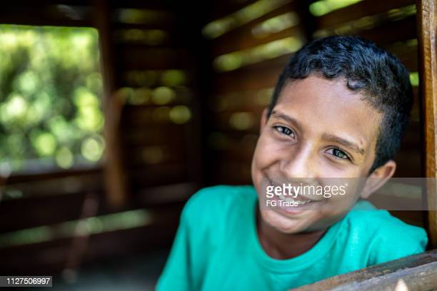 afro latino child at playground wooden house - pardo brazilian stock pictures, royalty-free photos & images